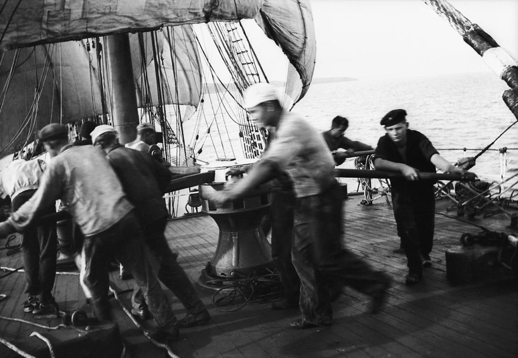 Sailors working at a capstan